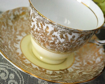 Colclough Cream, Yellow and Gold Floral Tea Cup and Saucer