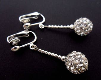 A pair of pretty white shamballa style dangly clip on earrings.