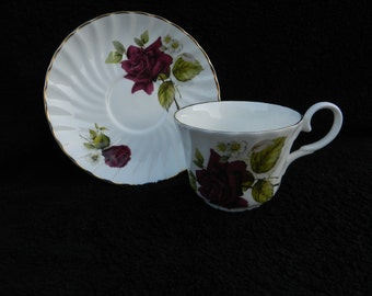 Vintage Tea Cup and Saucer: Hand decorated porcelain