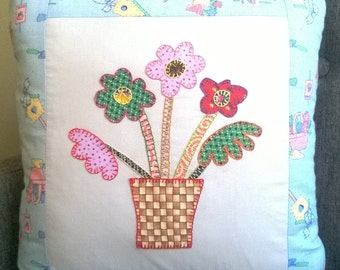 Handmade cushion with colourful embroidered flowers