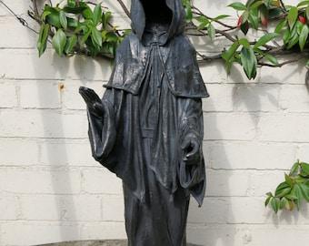 Mysterious medieval monk sculpture