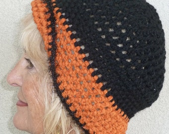 Original winter hat in team colors of black and orange, unique and versatile style hat, women's winter hat in quality handcrafted crochet