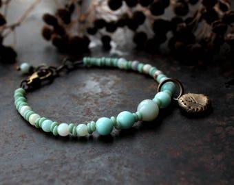 Norse charm bracelet, custom charm bracelet, rustic amulet bracelet, blue rune bracelet, sun or moon symbol bracelet, futhark bracelet