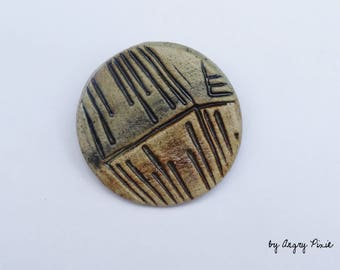Brown/Black/off-white ceramic brooch with texture. Geometric lines