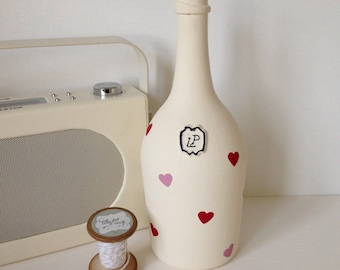 Hand painted Laurent Perrier champagne bottle finished with hearts