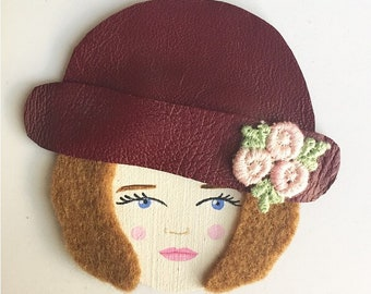 Brooch woman face with Hat flowers and raspberry leather lace of Calais