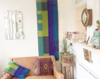 Colourful wall hangings woven on commission