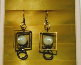 Geometric dangles, gold tone with white glass bead.
