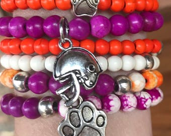 Clemson fans! Stretch stacker set of 6 stretch yoga bracelets. Six stacking bracelets in orange and purple with paw and helmet charms