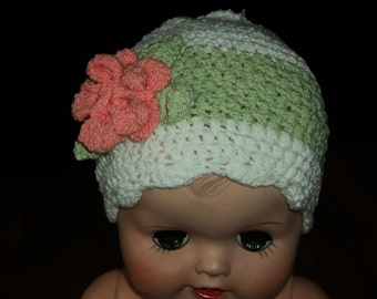 Pale green and white striped beanie with coral flower