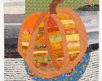 Fabric Art Wall Hanging,fabric collage, orange pieced pumpkin on a French blue plate,black,grey,green, and white pieced fabric background.