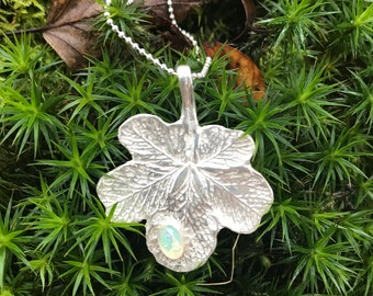 Real leaf pendant with one drop.