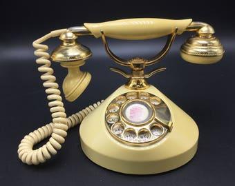 Vintage yellow french style rotary telephone. Mon Petit retro boudoir phone dainty