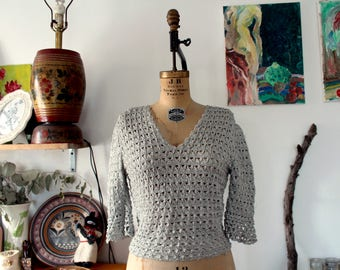 1960s 3/4 sleeve silver glitter lurex netted blouse with bell sleeves. small-medium