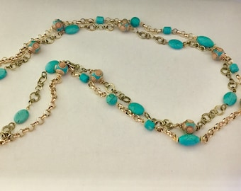 Long 2 strands golden chains with turquoise stones and Tibetan beads.