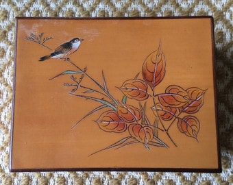 Wooden box with carved bird