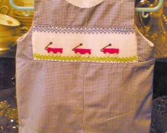 Smocked romper with red wagons