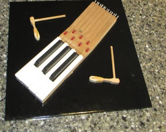 Piano Key Art Sculpture on Tile