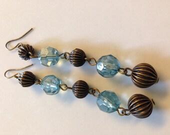 Blue bead and copper earrings. Blue earrings. Blue jewelry. Copper beads. Copper earrings.Copper jewelry. Dangly earrings. Dangles TBFB0801