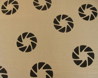 WHEEL TURNING - Handprinted fabric for home sewing, dressmaking, garment sewing. Natural fibers. Handprinted textiles - linen and rayon.