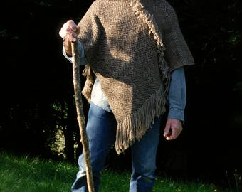 Poncho handwoven in rugged brown waxy wool in a Jacquard pattern