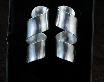 Hand Forged, Anticlastic raised, sterling silver post earrings.