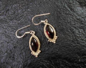 Sterling silver Garnet teardrop earrings   (being held today till 6:pm for LisaT.)