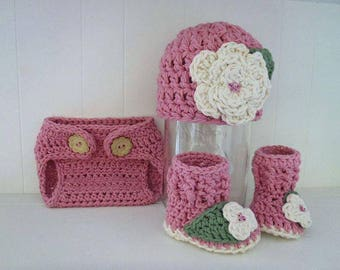 Layered together to cover baby hand crocheted soft wool hat + booties