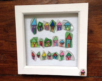 Seaside town houses in rows by the sea on seaglass in a wooden box frame -