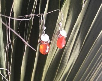 The Kierin earring silver discs and orange carnelian  briolette bead with silver fish hooks