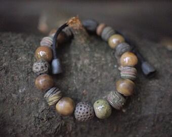 Artisan ceramic bracelet with handcrafted raku style textured glazed beads