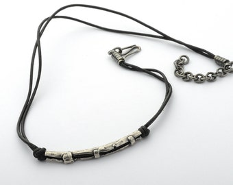 Silver chain with handmade clasp.