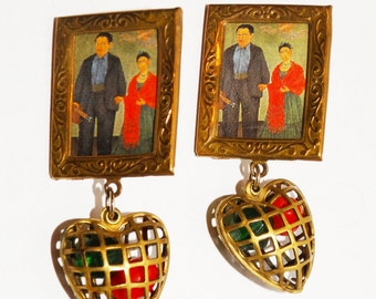 Vintage Brass Picture Holder with dangling Heart Earrings.