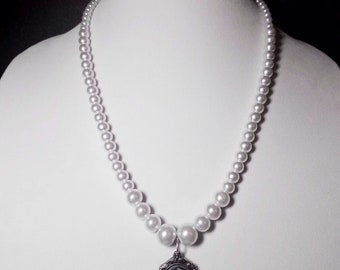 """White Cameo Pearl Necklace: 23"""" white Czech glass pearl necklace with skeleton cameo pendant. Portion of sale goes to charity."""