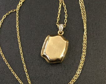 9ct gold locket with diamond top on chain
