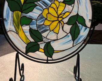 Yellow flower in swirl panel