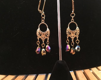 Earrings, dangle, beaded, multicolor Swarovski crystals on a gold drop ear charm.