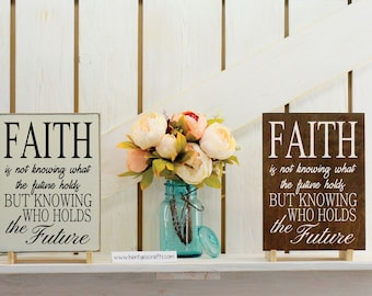 Faith is not knowing what the future holds but knowing who holds the future sign