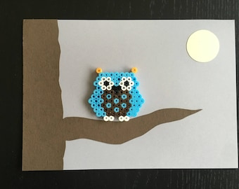 Decorative frame wall OWL on a branch