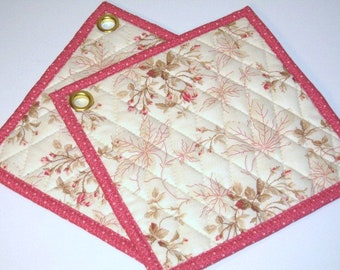 Romantic pot holders with smal flowers and beige leaves, fabric hot pads
