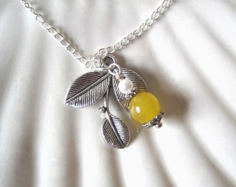 Three-leaf  silver pendant and yellow Jade bead with faux pearl on a necklace. Elegant.