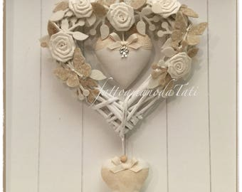 Heart/bow Birth in wicker decorated with roses, twigs, butterflies and two hearts in linen on shades of white and beige