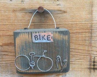 BIKE, small wire bike on reclaimed wood