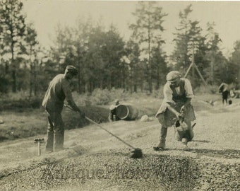 Men road construction with tools antique photo
