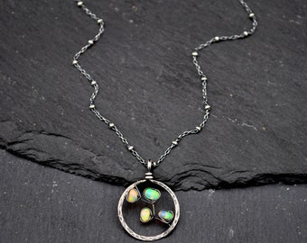 Welo opal necklace etsy genuine opal necklace hammered oxidized silver circle pendant flashy aaa natural ethiopian welo opal mozeypictures Gallery