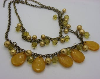 long necklace with bronze chains and drops beige caramel