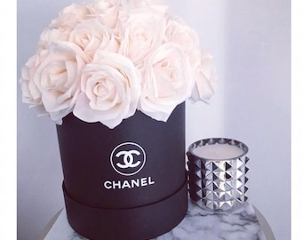 Chanel hatbox of flowers roses vase
