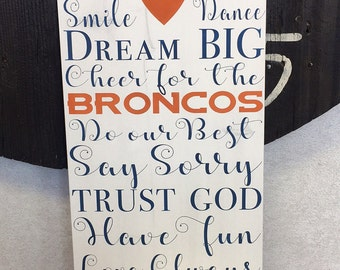 In this house Denver Bronco sign