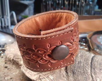 Upcycled, reclaimed, repurposed, recycled, upcycled, brown tooled leather bracelet. #1010