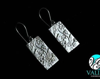 Rectangular pendant earrings with floral theme
